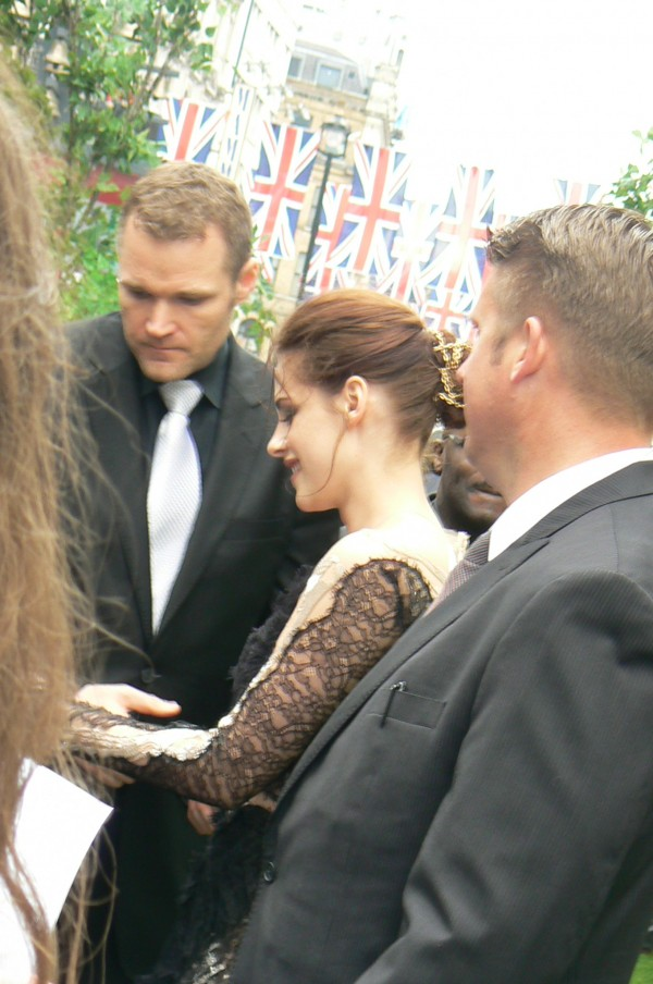 Kristen Stewart signing for fans at the SWATH World Premiere in London, May 2012. Photo by G.Williams.